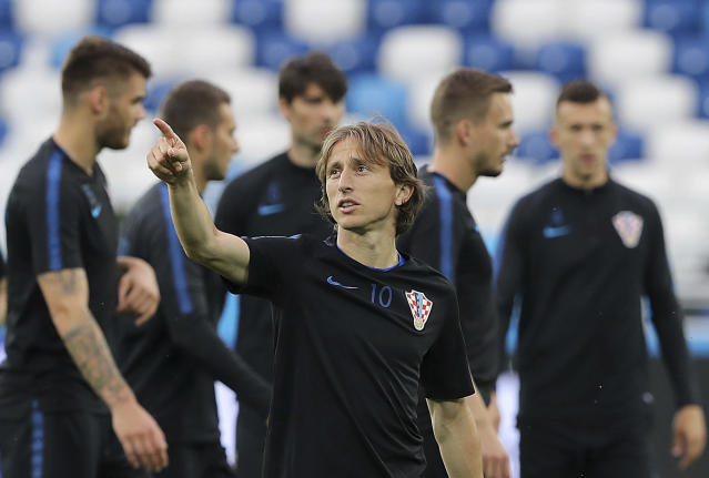 Croatia's Luka Modric points up during official training on the eve of the group D match between Croatia and Nigeria at the 2018 soccer World Cup in the Kaliningrad Stadium in Kaliningrad, Russia, Friday, June 15, 2018. (AP Photo/Czarek Sokolowski)