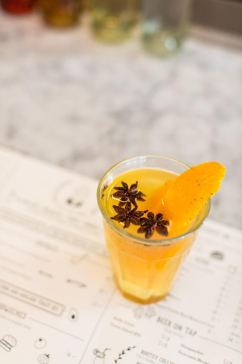 """<p>""""We like this drink because it's a mix of naughty and nice,"""" says Kate Waldron over at American-Mediterranean bistro <a href=""""http://jackswifefreda.com/"""" rel=""""nofollow noopener"""" target=""""_blank"""" data-ylk=""""slk:Jack's Wife Freda"""" class=""""link rapid-noclick-resp"""">Jack's Wife Freda</a>. """"You can keep it healthy and make it without the liquor or you can spice it up a notch and add some booze."""" </p> <p>2 oz Bourbon (optional)</p> <p>1 oz Honey Syrup</p> <p>8 oz Hot Water</p> <p>4 Dashes of Cayenne Pepper</p> <p>2 Star Anise</p> <p>3 Pieces of Ginger (Muddled Gently)</p> <p>Add all ingredients into a pot and bring to a boil. Remove and serve. </p>"""