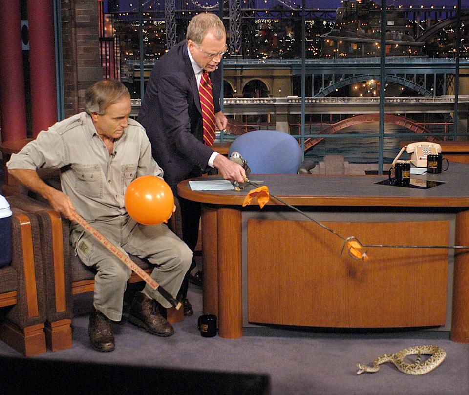 Jack Hanna, left, introduces a snake on David Letterman's