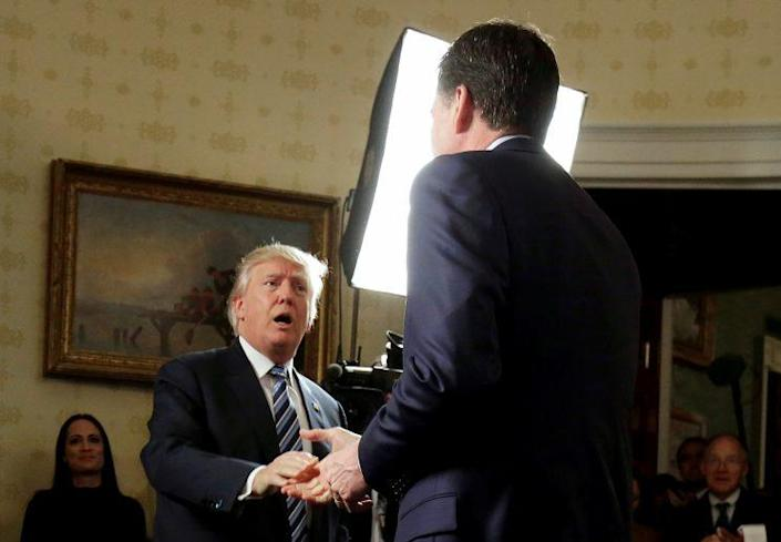 Trump greets Comey during a reception for law enforcement officers at the White House, Jan. 22, 2017. (Joshua Roberts/Reuters)