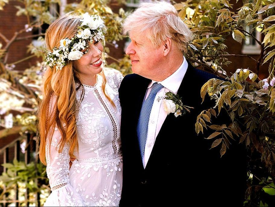<p>Boris Johnson and Carrie Johnson in the garden of 10 Downing Street after their wedding</p> (PA)