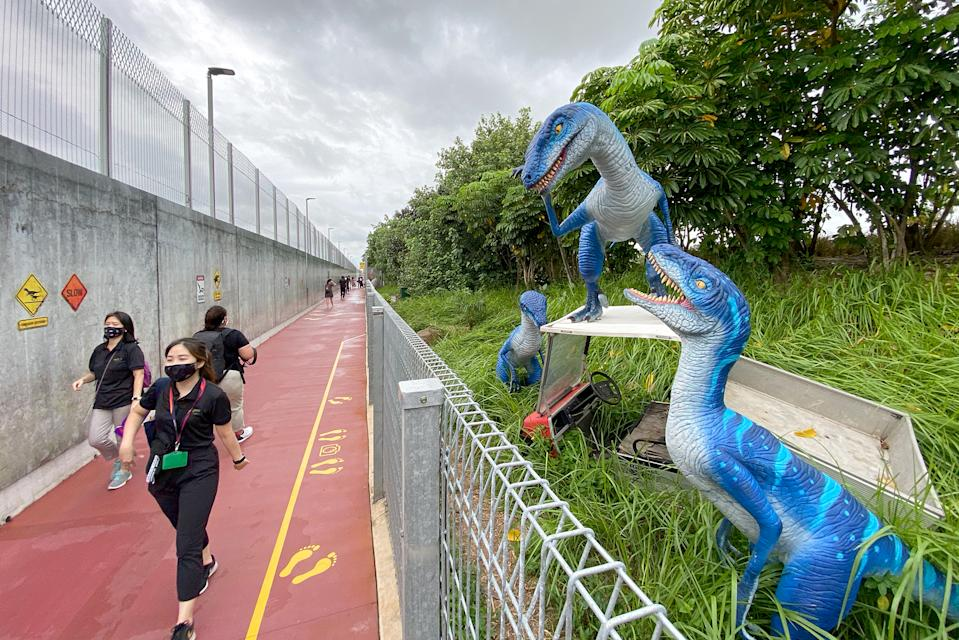 """Velociraptors seen on display along the """"Jurassic Mile"""" segment of the newly opened Changi Airport Connector on Sunday (11 October). (PHOTO: Dhany Osman / Yahoo News Singapore)"""