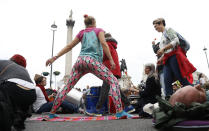 Demonstrators block Trafalgar Square in central London Monday, Oct. 7, 2019. Extinction Rebellion movement blocked major roads in London, Berlin and Amsterdam on Monday at the beginning of what was billed as a wide-ranging series of protests demanding new climate policies. (AP Photo/Alastair Grant)