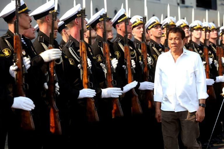 Philippine leader says pointless raising China's island-building at summit