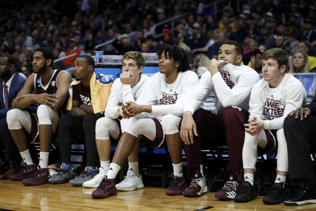 Texas A&M players sit on the bench during the second half of the team's NCAA men's college basketball tournament regional semifinal against Michigan on Thursday, March 22, 2018, in Los Angeles. (AP Photo/Jae Hong)