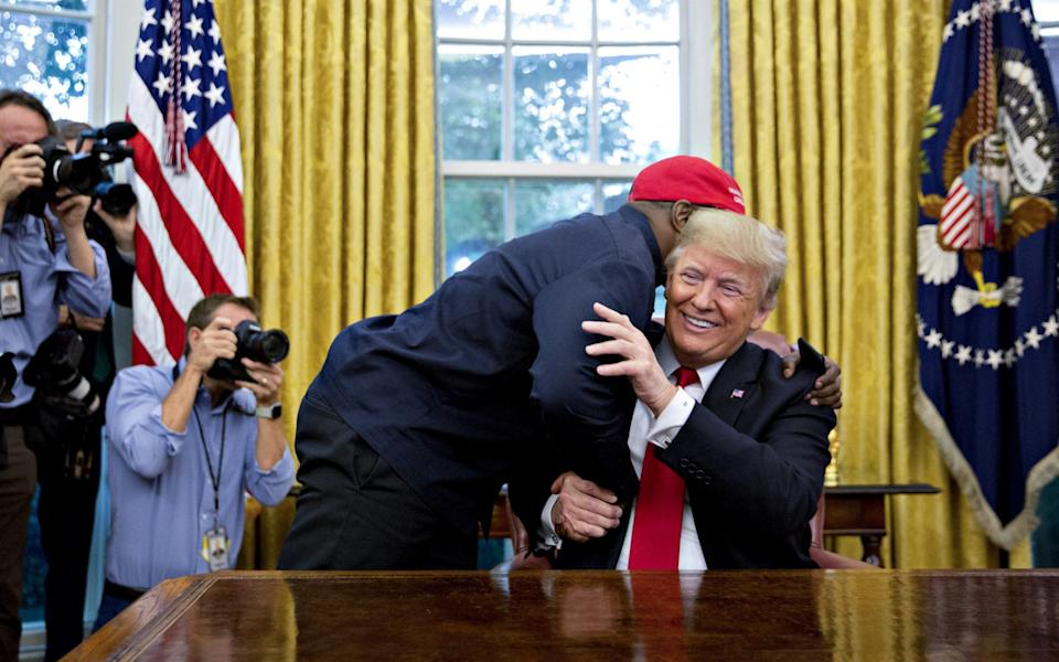 Kanye West in the Oval Office with Donald Trump, October 2018 - Bloomberg