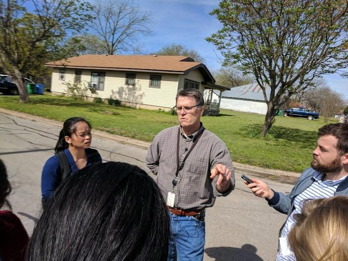 Mark Roessler, center, who lives across from Mark Conditt's house in Pflugerville, said he saw a man being taken into custody outside the home on Wednesday. (Photo: Roque Planas/HuffPost)