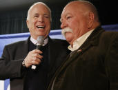 """FILE - In this Jan. 4, 2008, file photo, Republican presidential hopeful, Sen. John McCain, R-Ariz., left, introduces actor, Wilford Brimley, after making a reference to fellow Republican presidential hopeful, former Arkansas Gov. Mike Huckabee, campaigning with actor Chuck Norris, as McCain makes a campaign stop at Hudson Veterans of Foreign Wars Post 5791, in Hudson, N.H. Brimley, who worked his way up from stunt performer to star of film such as """"Cocoon"""" and """"The Natural,"""" has died. He was 85. Brimley's manager Lynda Bensky said the actor died Saturday morning, Aug. 1, 2020 in a Utah hospital. (AP Photo/Charles Dharapak, File)"""