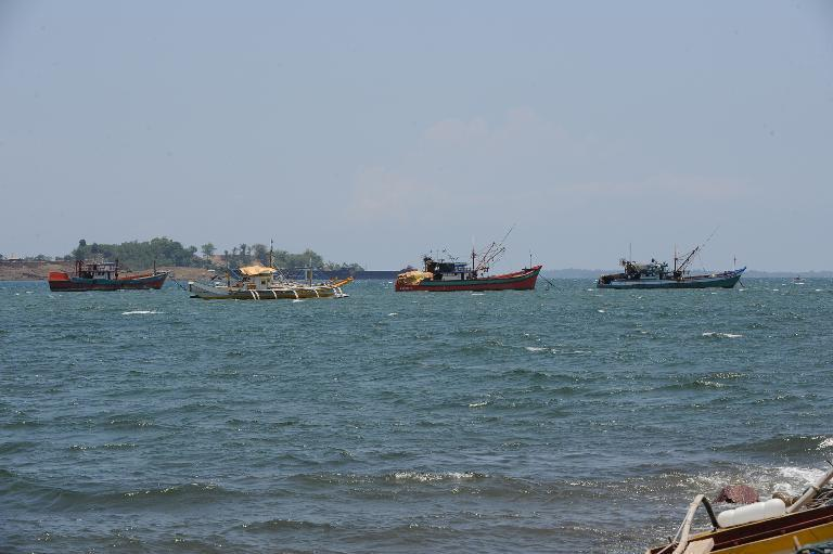 File photo shows fishing boats anchored off Santa Cruz bay, Zambales province, near the South China Sea on May 10, 2012, after arriving from the Scarborough Shoal