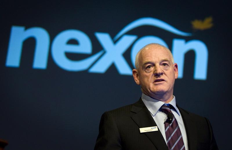 In this April 25, 2012 photo, Nexen chief executive Kevin Reinhart addresses the company's annual meeting in Calgary, Alberta. Oil and gas producer Nexen Inc. has agreed to be acquired by China National Offshore Oil Company for US$15.1 billion cash. (AP Photo/The Canadian Press, Jeff McIntosh)