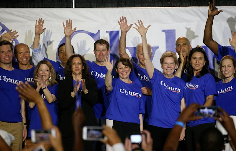 Democratic presidential candidates stand on stage together, including all of the women running, Marianne Williamson, Sen. Kamala Harris, Sen. Amy Klobuchar, Sen. Elizabeth Warren, Rep. Tulsi Gabbard, and Sen. Kirsten Gillibrand during Jim Clyburn's World Famous Fish Fry in Columbia, South Carolina, U.S., June 21, 2019. Picture taken June 21, 2019. REUTERS/Leah Millis