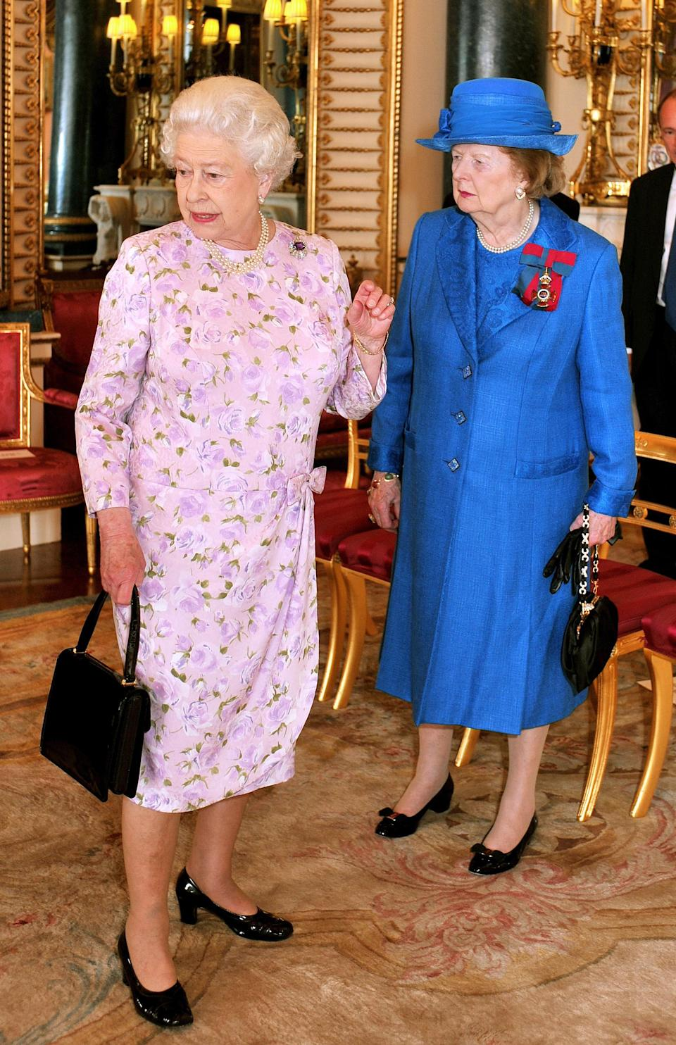 Queen Elizabeth II (left) and Baroness Margaret Thatcher before lunch for members of the Order of Merit at Buckingham Palace in London.   (Photo by John Stillwell - PA Images/PA Images via Getty Images)