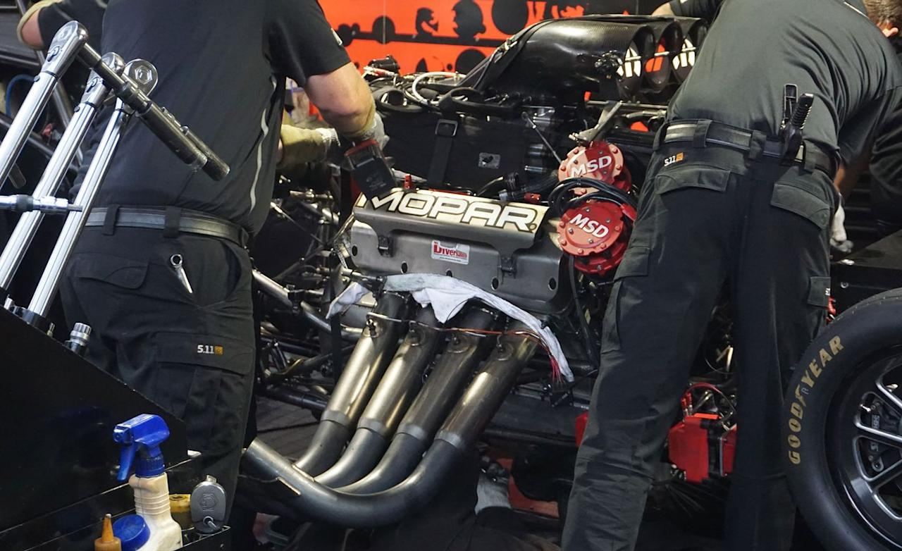 <p>The Funny Car's key component is an 8.1-liter (496 cubic inch!) V-8 developing about 11,000 horsepower and some 8000 lb-ft of torque. Oh, and it is capable of revving to 8500 rpm. The engine is a development of the legendary 426 Hemi V-8, using a block and heads machined from solid aluminum billets. This is possible because the engine has no water passages. Its usual running time is so short, it gets by without a liquid cooling system. The compression ratio is about 6.5 to 1.</p>