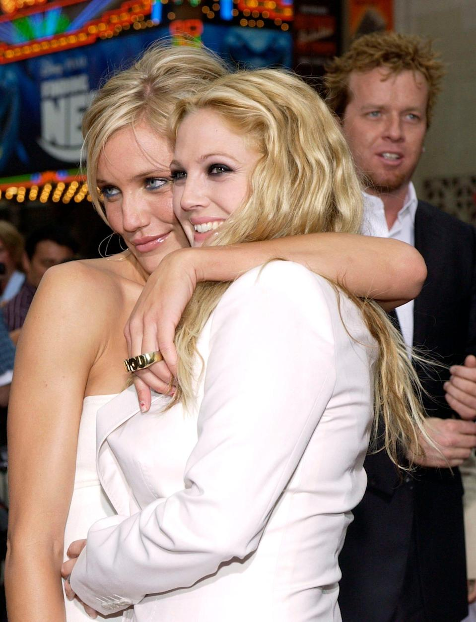 """Cameron Diaz, left, and Drew Barrymore arrive at the premiere of """"Charlie's Angels: Full Throttle,"""" on June 18, 2003, in the Hollywood Section of Los Angeles."""