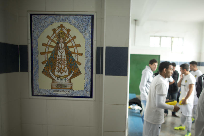 "Soccer players from the new team ""Papa Francisco,"" or Pope Francis, get ready for a game in their locker room decorated with an image of Our Lady of Lujan, Argentina's Patron Saint in Lujan, Argentina, Saturday, April 12, 2014. The new semiprofessional team named their team in honor of the pontiff from Argentina. (AP Photo/Victor R. Caivano)"