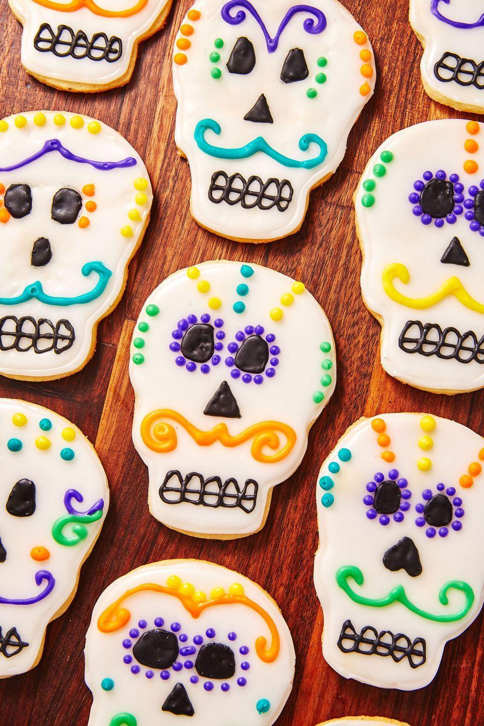 "<p>These colorfully decorated sugar cookies are almost too pretty to eat.</p><p>Get the recipe from <a href=""https://www.delish.com/holiday-recipes/halloween/a29005020/day-of-the-dead-cookies-recipe/"" rel=""nofollow noopener"" target=""_blank"" data-ylk=""slk:Delish"" class=""link rapid-noclick-resp"">Delish</a>.</p>"