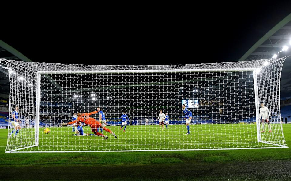 Brighton and Hove Albion goalkeeper Robert Sanchez fails to stop Arsenal's Alexandre Lacazette from scoring his side's first goal of the game during the Premier League match - PA