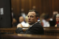 Olympic and Paralympic track star Oscar Pistorius sits in the dock on the third day of his trial for the murder of his girlfriend Reeva Steenkamp at the North Gauteng High Court in Pretoria, March 5, 2014.REUTERS/Alon Skuy/Pool (SOUTH AFRICA - Tags: SPORT ATHLETICS CRIME LAW)