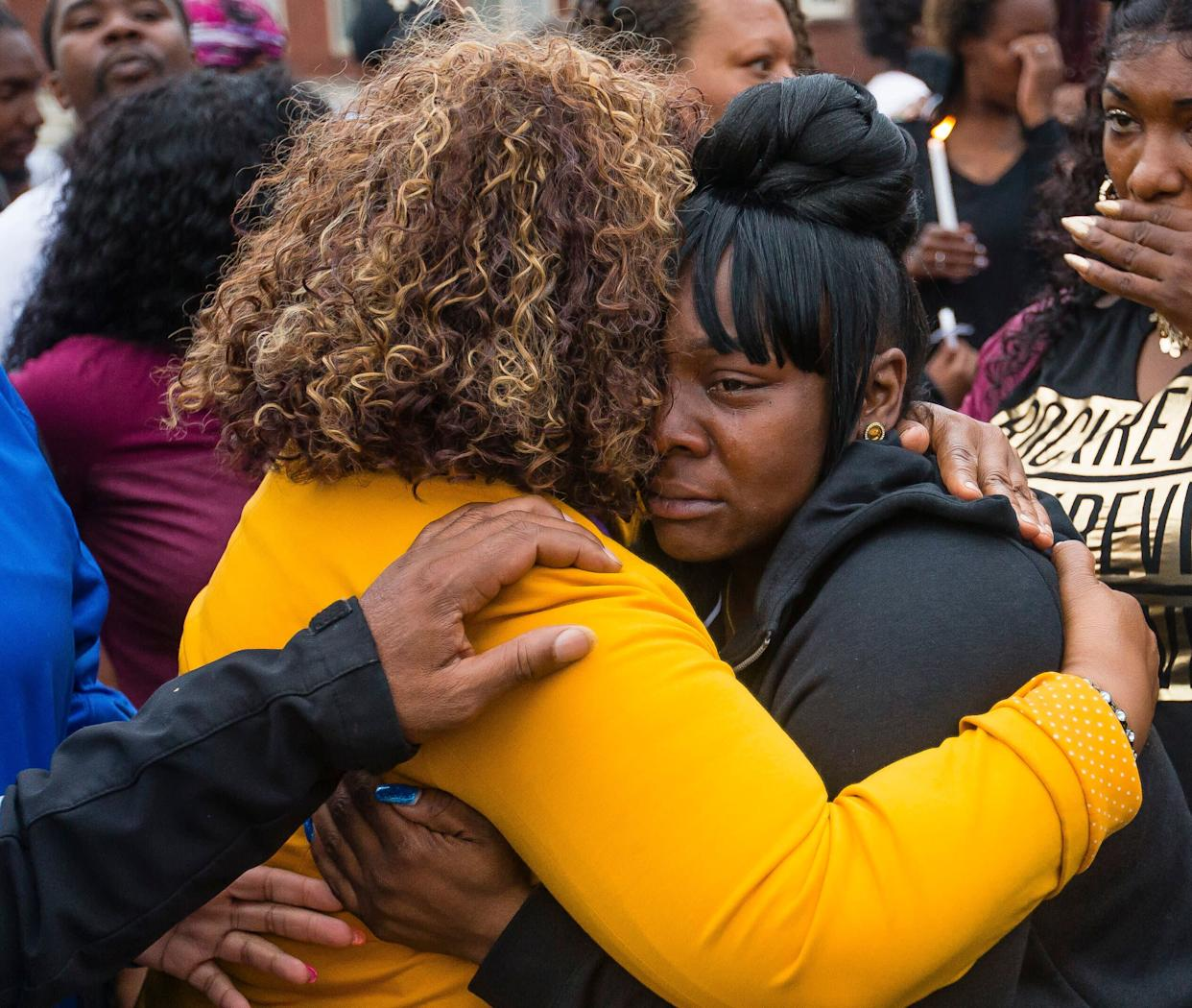 Family members embrace one another during a vigil for Eric Logan Monday, June 17, 2019, on Washington Street in South Bend, Ind. (Photo: ASSOCIATED PRESS)