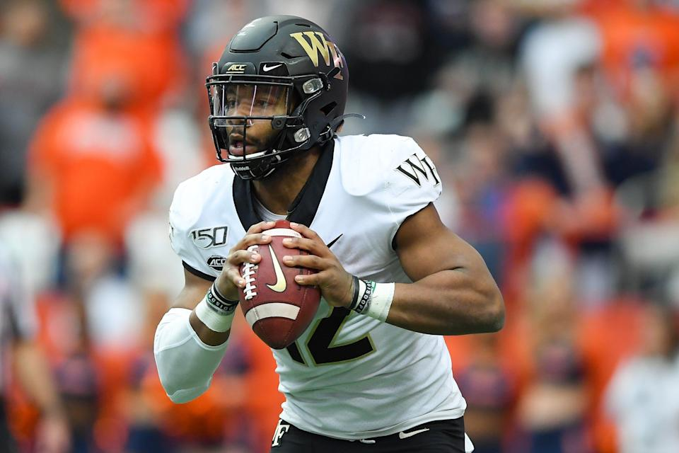 Wake Forest Demon Deacons quarterback Jamie Newman (12) runs with the ball against the Syracuse Orange during the first quarter at the Carrier Dome.