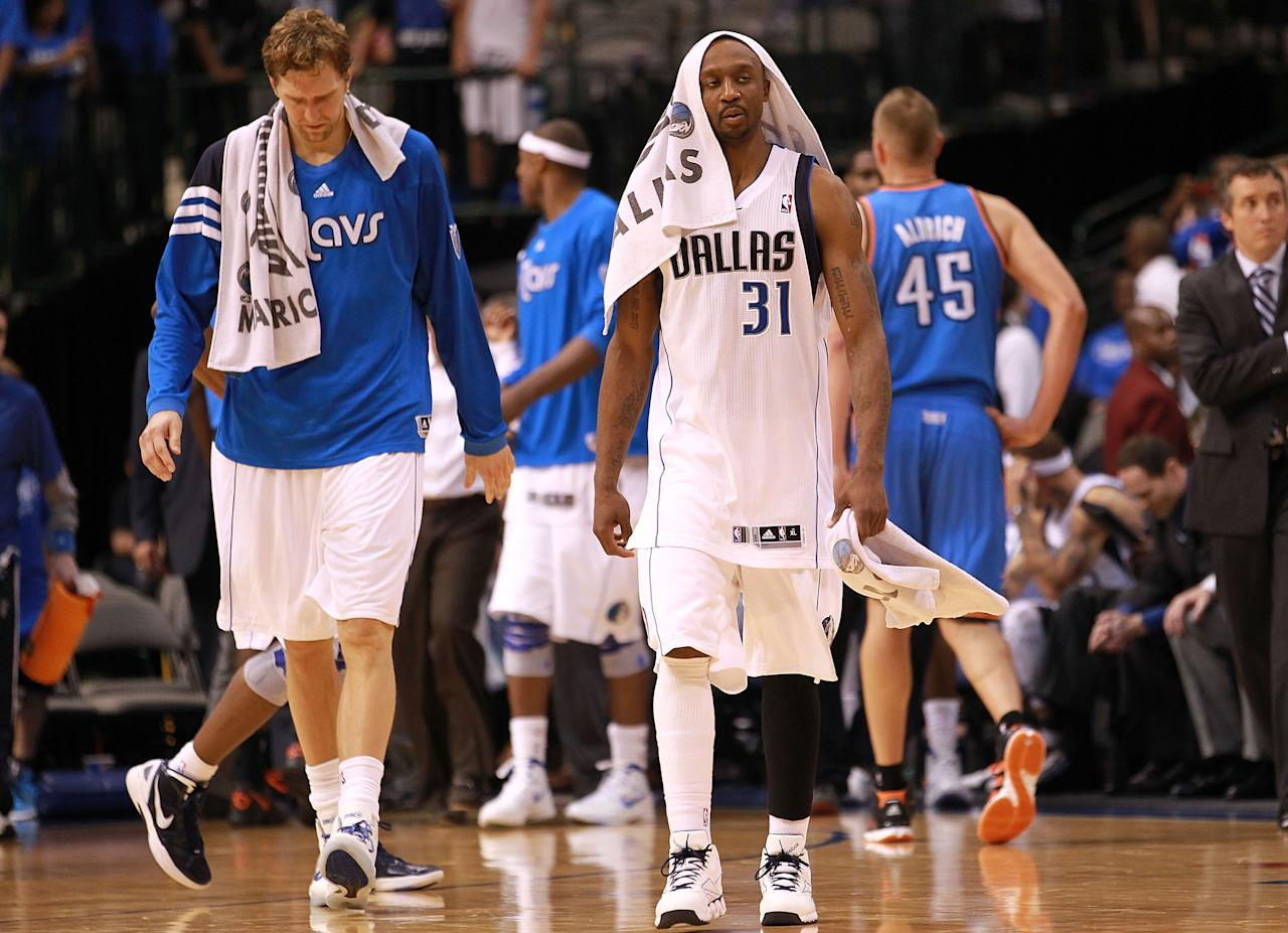 DALLAS, TX - MAY 03:  (L-R) Dirk Nowitzki #41 and Jason Terry #31 of the Dallas Mavericks walk off the court after a loss to the Oklahoma City Thunder during Game Three of the Western Conference Quarterfinal at American Airlines Center on May 3, 2012 in Dallas, Texas.  NOTE TO USER: User expressly acknowledges and agrees that, by downloading and or using this photograph, User is consenting to the terms and conditions of the Getty Images License Agreement.  (Photo by Ronald Martinez/Getty Images)