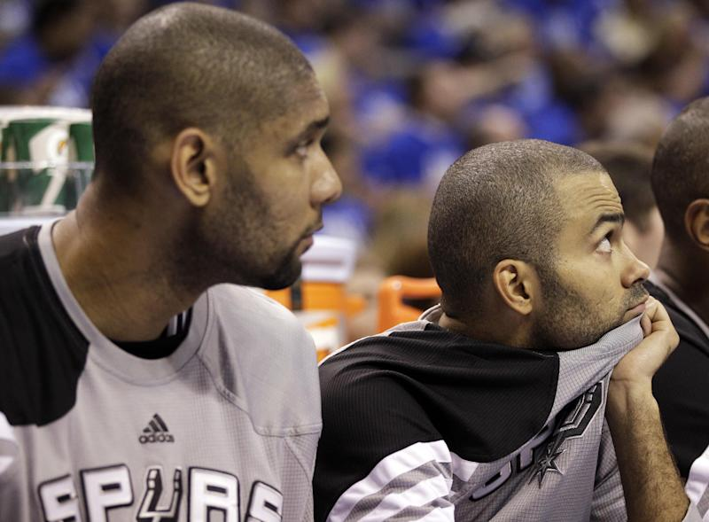 San Antonio Spurs center Tim Duncan, left, and point guard Tony Parker, of France, watch from the bench against the Oklahoma City Thunder during the second half of Game 3 in their NBA basketball Western Conference finals playoff series, Thursday, May 31, 2012, in Oklahoma City. The Thunder won 102-82. (AP Photo/Eric Gay)