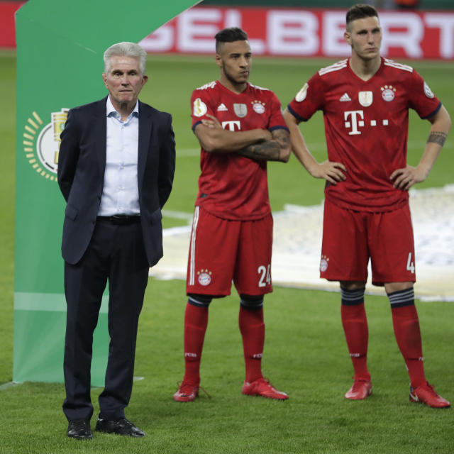 Bayern coach Jupp Heynckes stands on the pitch after the German soccer cup final match between FC Bayern Munich and Eintracht Frankfurt in Berlin, Germany, Saturday, May 19, 2018. (AP Photo/Michael Sohn)