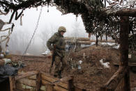 A Ukrainian soldier takes position on the front line at the town of Novoluhanske in the Donetsk region, Ukraine, Monday, Dec. 9 2019. A long-awaited summit in Paris on Monday aims to find a way to end the war in eastern Ukraine, a conflict that after five years and 14,000 lives lost has emboldened the Kremlin and reshaped European geopolitics. (AP Photo/Vitali Komar)
