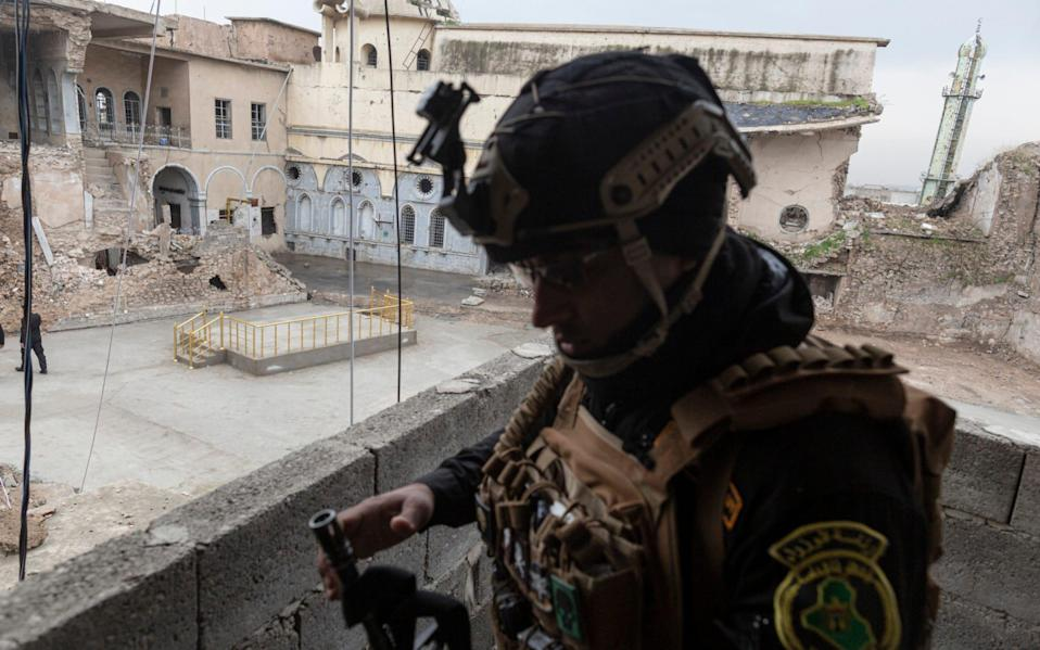 soldier stands guard over The Al Tahira Orthodox Church in the Old City of Mosul, Iraq, on March 4th, 2021. On March 6th, - Sam Tarling for the Telegraph