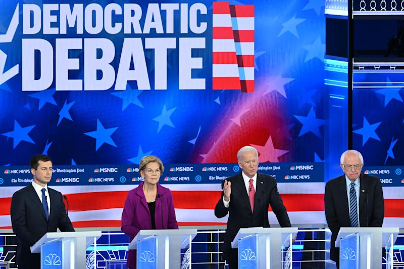 Democratic presidential hopefuls (L-R) Mayor of South Bend, Indiana, Pete Buttigieg, Massachusetts Senator Elizabeth Warren, Former Vice President Joe Biden and Vermont Senator Bernie Sanders speak during the fifth Democratic primary debate of the 2020 presidential campaign season co-hosted by MSNBC and The Washington Post at Tyler Perry Studios in Atlanta, Georgia on November 20, 2019. (Photo by SAUL LOEB / AFP) (Photo by SAUL LOEB/AFP via Getty Images)