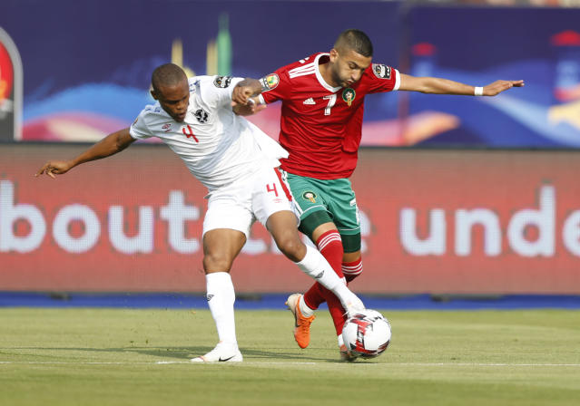 Morocco's Hakim Ziyach, right, and Namibia's Riaan Hanamub fight for the ball during the African Cup of Nations group D soccer match between Morocco and Namibia in Al Salam Stadium in Cairo, Egypt, Sunday, June 23, 2019. (AP Photo/Ariel Schalit)