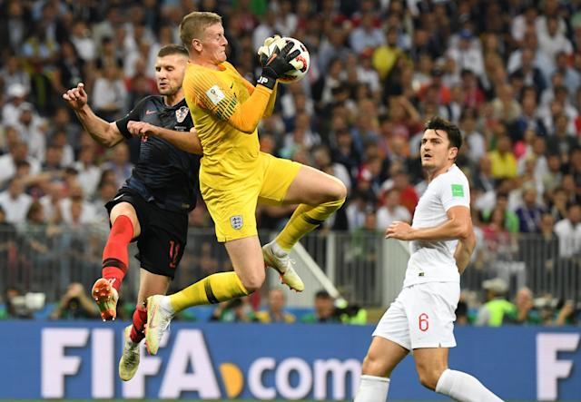 <p>England's goalkeeper Jordan Pickford (C) stops a shot on goal by Croatia's forward Ante Rebic (L) next to England's defender Harry Maguire (R) during the Russia 2018 World Cup semi-final football match between Croatia and England at the Luzhniki Stadium in Moscow on July 11, 2018. (Photo by YURI CORTEZ / AFP) </p>