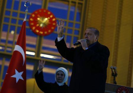Turkish President Erdogan addresses his supporters at the Presidential Palace in Ankara