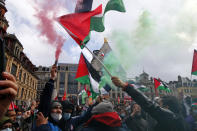 People hold Palestinian flags and flares during a demonstration in Lille, northern France, Saturday May 15, 2021. Marches in support of Palestinians in the Gaza Strip were being held Saturday in a dozen French cities, but the focus was on Paris, where riot police got ready as organizers said they would defy a ban on the protest. (AP Photo/Michel Spingler)