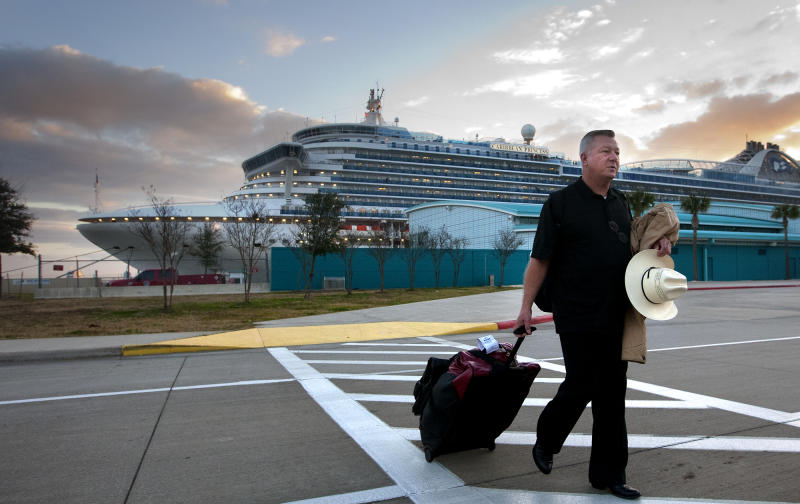 Jack Doebbler walks to his vehicle after getting off the Caribbean Princess cruise ship, Friday, Jan. 31, 2014, in La Porte, Texas. The ship returned to port early on Friday due to a dense fog advisory and not because people were vomiting and had diarrhea, a Princess Cruises spokeswoman said Friday. But passengers said the crew announced on the second day of the cruise that people were sick, apparently with highly contagious norovirus, and that extra precautions were being taken to ensure it didn't spread. (AP Photo/Houston Chronicle, Cody Duty)