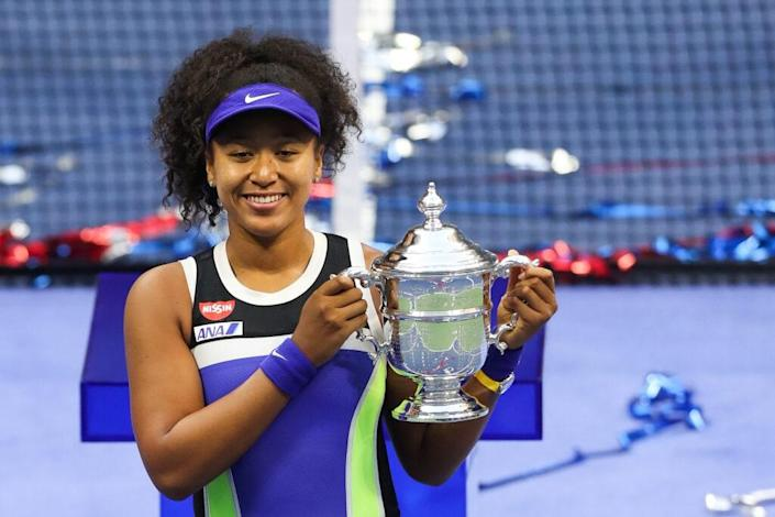 Naomi Osaka of Japan celebrates with the trophy after winning her Women's Singles final match against Victoria Azarenka of Belarus on Day Thirteen of the 2020 US Open at the USTA Billie Jean King National Tennis Center on September 12, 2020 in the Queens borough of New York City. (Photo by Matthew Stockman/Getty Images)