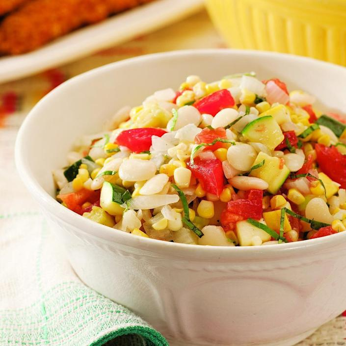 <p>This summer salad is based on the Southern favorite, succotash, and is a fresh-tasting combination of butter beans, corn, summer squash and tomatoes. Butter beans, the same species as lima beans, are the bean of choice in the South. When they're in season you may be able to find them fresh-shell them yourself. Or use frozen butter beans, baby lima beans or even edamame.</p>