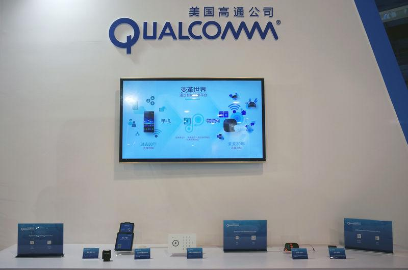 Booth of U.S. chipmaker Qualcomm is pictured at an expo in Beijing