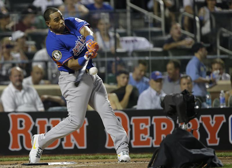 American League's Yoenis Cespedes, of the Oakland Athletics, hits his fourth home run during the first round of the MLB All-Star baseball Home Run Derby, on Monday, July 15, 2013 in New York. (AP Photo/Matt Slocum)