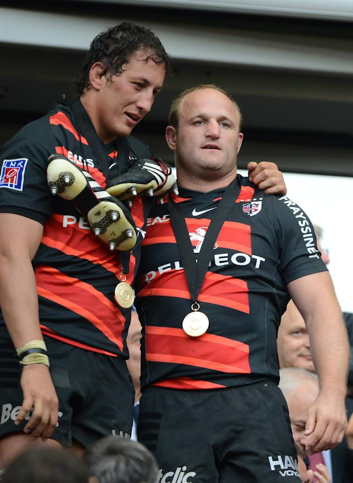 Toulouse's French hooker William Servat (R) and Toulouse's Argentinian lock Patricio Albacete celebrate after winning the French Top 14 rugby union final match Toulouse vs Toulon, on June 9, 2011 at the Stade de France in Saint-Denis, outside Paris. Toulouse won 18-12.  AFP PHOTO / MARTIN BUREAUMARTIN BUREAU/AFP/GettyImages