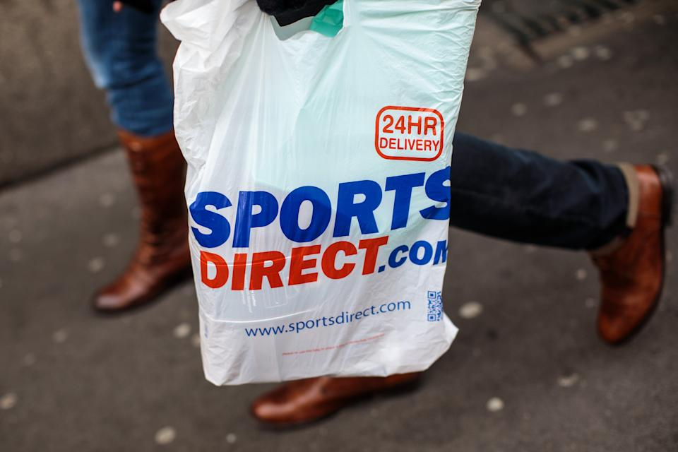 LONDON, ENGLAND - DECEMBER 27: A plastic Sports Direct bag is carried by a shopper on December 27, 2018 in London, England. England's current 5-pence fee for plastic shopping bags could double in 2020, under plans announced by Environment Secretary Michael Gove. The levy would also apply to smaller retailers currently exempted from the law. (Photo by Jack Taylor/Getty Images)