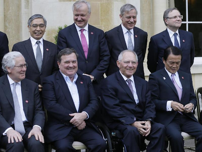 "From left, Mervyn King, Governor of the Bank of England, Jim Flaherty, Finance Minister of Canada, Wolfgang Schauble Federal Minister of Finance of Germany and Taro Aso, Finance Minister of Japan, pose for the family group photo at the G7 finance ministers and central bank governors meeting in Aylesbury, England, Friday, May 10, 2013. The role of central banks in shoring up the global economic recovery is set to be a key point of discussion among top financial officials from the world's seven leading economies when they gather in the UK this weekend. In a statement Friday ahead of the Group of Seven's two-day meeting at a country house around 50 miles (80 kilometers) northwest of London, British finance minister George Osborne said the main task officials face over the coming two days is looking at how to ""nurture"" the recovery. (AP Photo/Alastair Grant, Pool)"