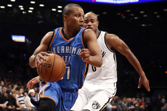 FILE - In this Nov. 3, 2014, file photo, Oklahoma City Thunder guard Sebastian Telfair, front, dribbles past Brooklyn Nets guard Jarrett Jack (0) in the first half of an NBA basketball game in New York. Former NBA player Telfair has been sentenced to 3 1/2 years in prison in a New York City gun case. Brooklyn District Attorney Eric Gonzalez said on Monday, Aug. 12, 2019, that Telfair received the term for his conviction in April on a gun-possession charge. (AP Photo/John Minchillo, File)