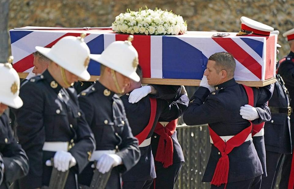 The coffin of Major General Matthew Holmes, former head of the Royal Marines, is carried into Winchester Cathedral (Andrew Matthews/PA) (PA Wire)