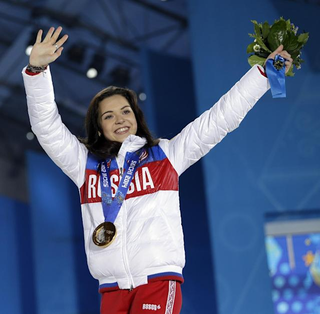 Women's free skate figure skating gold medalist Adelina Sotnikova of Russia waves during the medals ceremony at the 2014 Winter Olympics, Friday, Feb. 21, 2014, in Sochi, Russia. (AP Photo/David Goldman)