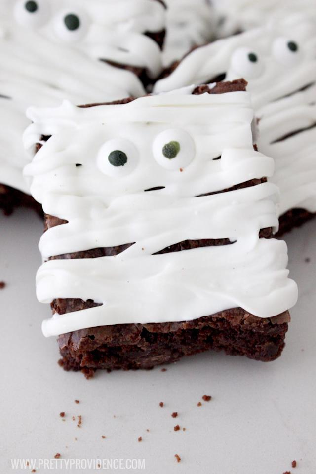 "<p><span>For an easy Halloween transformation, <span></span>cover these brownies with frosting and candy eyes.</span></p><p><strong>Get the recipe at <a rel=""nofollow"" href=""http://prettyprovidence.com/easy-mummy-brownies/"">Pretty Providence</a>. </strong></p><p><strong>Tools you'll need: </strong><span><em>$11, Festival Candy Eyes Treat Toppers<span>, </span><a rel=""nofollow"" href=""https://www.amazon.com/Festival-Candy-Treat-Toppers-Ounce/dp/B00IF8B3OG?tag=syndication-20"">amazon.com</a></em></span></p>"