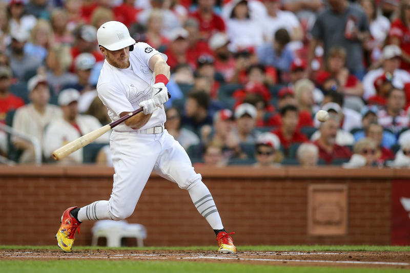 St. Louis Cardinals' Harrison Bader swings for a two-run home run during the second inning of the team's baseball game against the Colorado Rockies on Saturday, Aug. 24, 2019, in St. Louis. (AP Photo/Scott Kane)
