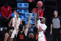 Houston guard DeJon Jarreau (3) shoots over Oregon State forward Warith Alatishe (10) during the second half of an Elite 8 game in the NCAA men's college basketball tournament at Lucas Oil Stadium, Monday, March 29, 2021, in Indianapolis. (AP Photo/Darron Cummings)