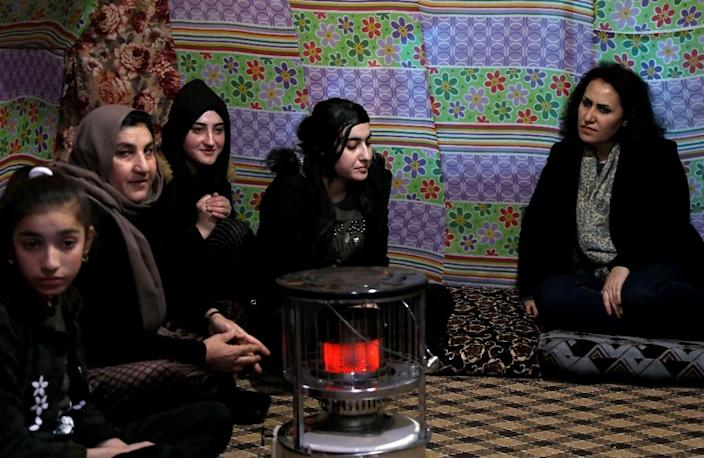 """""""The fact that I'm from the same sect played a huge role. It allowed them to feel closer to me, to trust me, to break that wall of fear,"""" Nagham Hasan told AFP (AFP Photo/SAFIN HAMED)"""