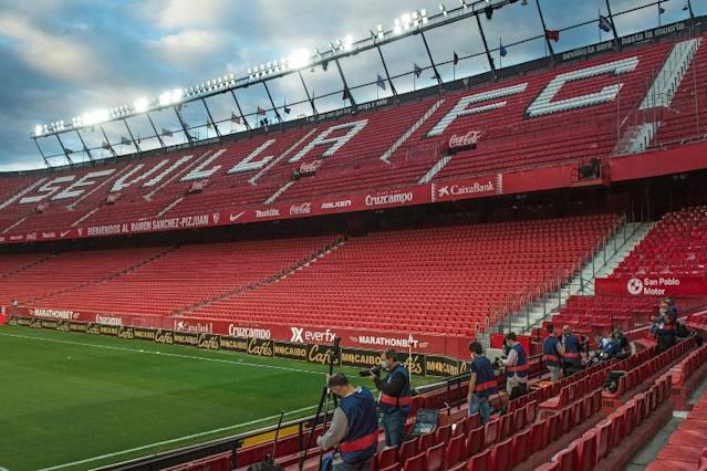 Picture this: Photographers wait for the start of the Spanish League match between Sevilla and Real Betis at the Ramon Sanchez Pizjuan stadium (AFP Photo/CRISTINA QUICLER)